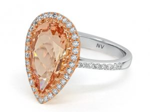 18ct white gold ladies ring set with 1x 4.39ct Morganite and 49=.46 round brilliant cut diamonds.