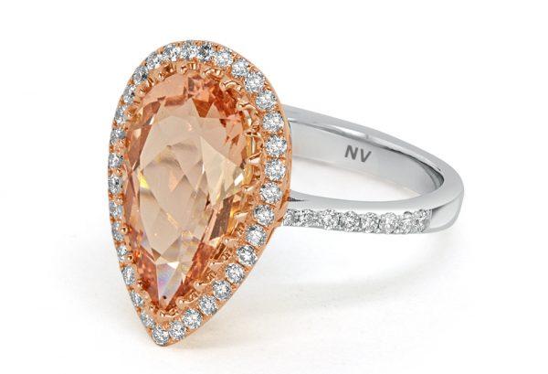 18ct white gold ladies ring set with 1x 4.39ct Morganite and 49=.46 round brilliant cut diamonds.