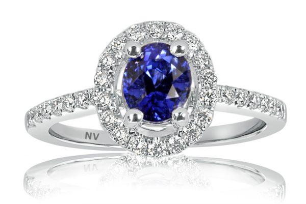 18ct white gold ladies ring set with 1.26ct Ceylon Sapphire and 32=.39ct round brilliant cut diamonds.