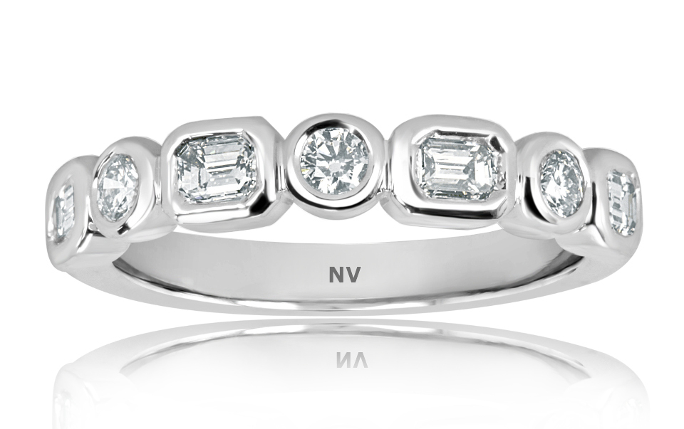 18ct white gold ladies ring set with 4=.44ct Emerald cut diamonds and 3=.19ct round brilliant cut diamonds,