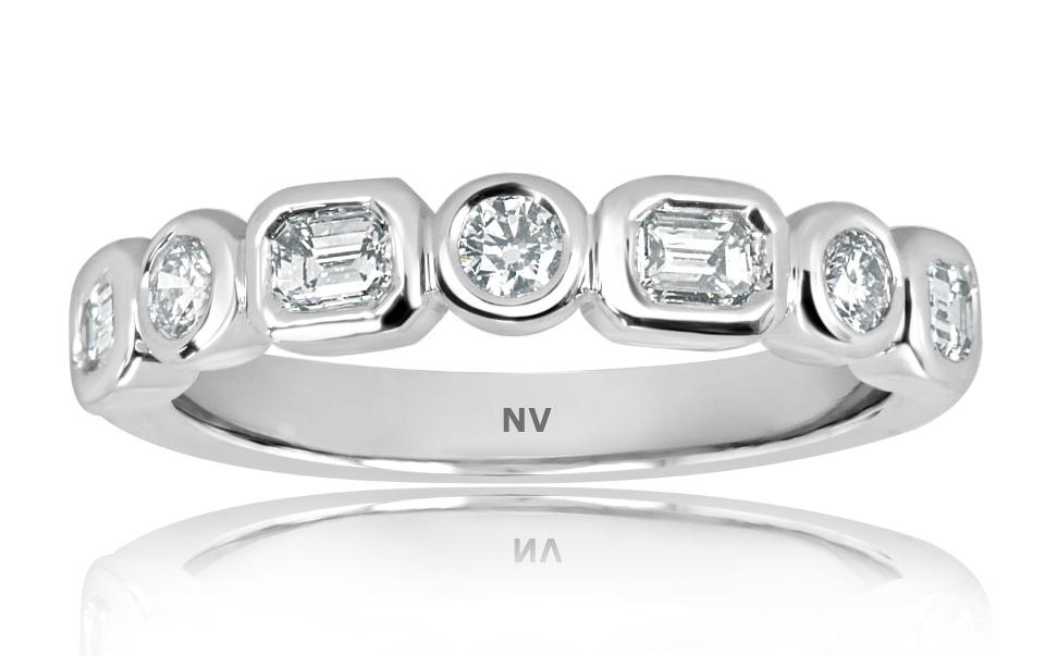 18ct white gold ladies ring set with 4=.44ct Emerald cut diamonds and 3=.19ct round brilliant cut diamonds,
