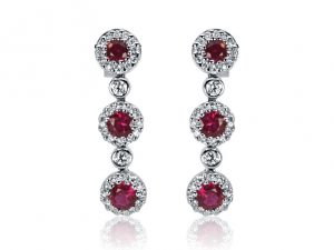 18ct White Gold Ladies Drop Design Earrings set with 6=.94ct Natural Rubies and 76=.37ct round Brilliant cut Diamonds. $1700.00