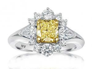 18ct white gold ladies engagement ring set with 1x1.00 Fancy Intense Yellow Diamond, Clarity VS1 GIA Certified and 2=.40ct pear shape, 10=.43ct round brilliant cut diamonds.