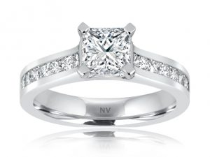 18ct White Gold Ladies engagement ring set with 1x1.05ct Radiant cut Diamond, GIA Certified Colour F, Clarity SI1 and 16 princess cut diamonds in channel settings.