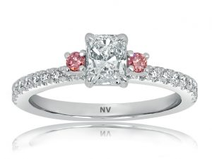 18ct White Gold Ladies engagement ring set with 1x.62ct Radiant cut Diamond, AUSCERT Certified Colour F, Clarity VS2 and 2=.08ct Argyle Pink Diamonds with 20=.20ct round diamonds.